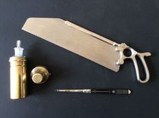 19 medical instruments including an amputation saw (saw blade is removable) .19th century surgery instrument with silver parts, brass holder with bottle dropper, origin England