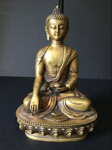 Representation of Buddha Shakyamuni in patinated copper - Nepal - late 20th century.