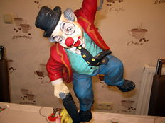 Clown hanging on Balloons