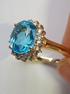 Special, beautiful gold ring with natural London Blue Topaz (6 ct) and diamonds, 0.36 ct