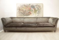 A grey velour-coated very large sofa, late 20th century