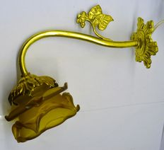Gold plated Art Nouveau wall lamp with amber yellow pressed glass shade