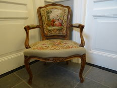 Classic romantic chair with tapestry upholstery