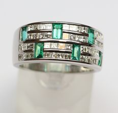 Gold ring with natural diamonds totalling 2.30 ct and emeralds totalling about 0.80 ct.