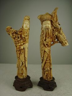 Stag horn sculptures of an emperor and an empress – China – first half 20th century