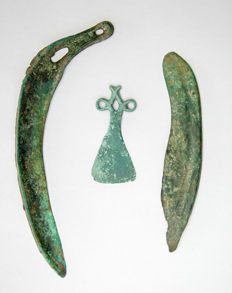 Collection of bronze objects: amulet - 80 mm, sickle axe head - 220 mm, knife 160 mm (3)