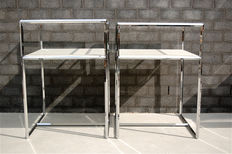 Two vitrine or display cases in chromed metal.