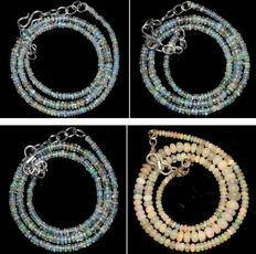 Lot with 4 necklaces of natural Welo opals, measuring 2 to 6.5 mm.