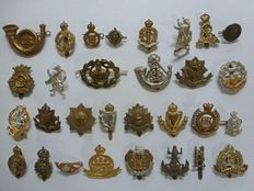 Collection of 30 different British emblems for beret / collar