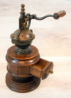Large wooden retro coffee grinder with cast iron grinding mechanism
