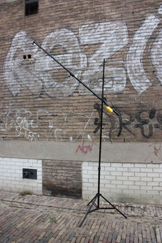 Lamp tripod with boom arm and counterweight