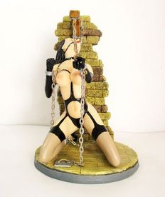 Figurine; Chained young woman - 21st century