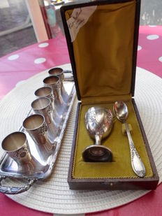 Serving of 6 silver metal cups on tray + egg cup and silver metallic spoon finely chopped