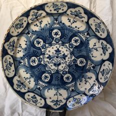 18th century, richly decorated plate made of Delft earthenware