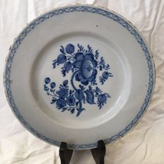 18th century Delft earthenware plate with poppies