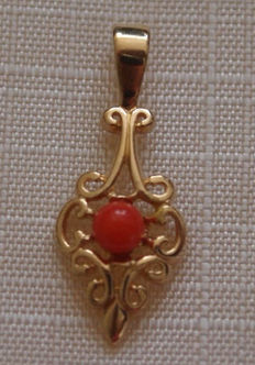 Gold cutaway pendant with red coral