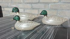 Set of 3 copper ducks.