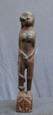 Antique figurine of a woman with snake - West Sumba - Indonesia.