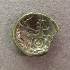 Gaul – Sequanes-Helvetes (now Switzerland) – Quarter stater with horse and rouelle. 2nd-1st century BC