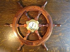Classic hand-made steering wheel with brass clock