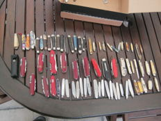 Large collection of 60 pen knives, some swiss army, others vary