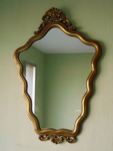 Baroque mirror with gilded frame