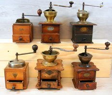 "Collection of 6 antique wooden coffee grinders with ""brands"" picture"
