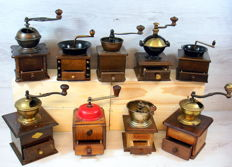 Collection of 9 antique wooden coffee grinders