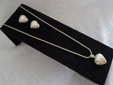 Silver, hand-carved, heart medallion (21 x 30 x 8 mm) with silver cord link necklace - length 61 cm and matching, clip-on earrings.