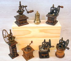 Collection of seven special pepper mills in wood and metal