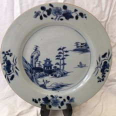 Porcelain plate, Group of Indians, white and blue - China - 18th Century
