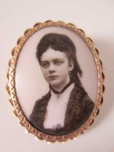 Gold brooch with porcelain portrait and hair work.