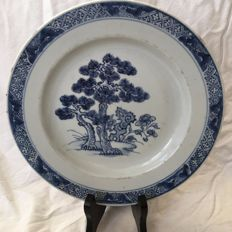 Kangxi plate with trees and flowers in a landscape - China - 18th century