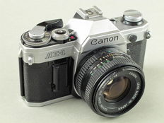 Canon AE-1, 1.8/50 mm., 3.5/135 mm., with accessories.