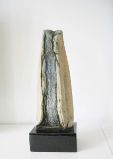 Abstract ceramic sculpture on a black granite base, signed