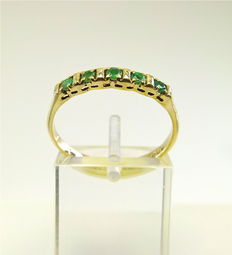 Vintage gold band ring channel set with 5 Emeralds