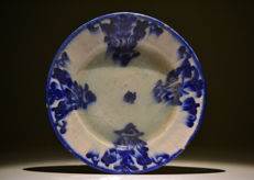 A Qajar blue and white glaze earthenware plate, Mirhab – Persia – early 19th century