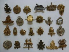 Collection of 25 different British emblems for beret / collar