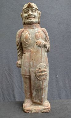 Sculpture of a warrior with a large shield  Height  48 cm. Width: 14,7 cm .