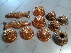 Old copper moulds for cakes and puddings, fish-shaped and round shaped
