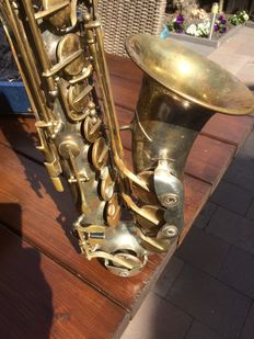 An alto saxophone in case THE New King with (accessories) year unknown