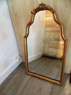 Baroque sleek mirror with gilded frame