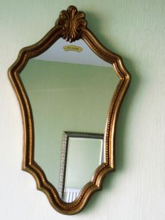 Baroque frame with gold leaf ornaments and mirror