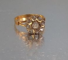 Gold ring with rose cut diamonds.