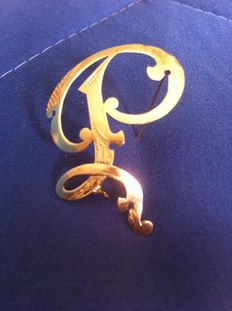 Gold brooch/lapel pin from 1963.