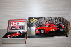 Hot Wheels / La Storia - Scale 1/18-1/43 - Ferrari 2001 Spa Francorchamps - M. Schumacher & Ferrari F2002 - R. Barrichello