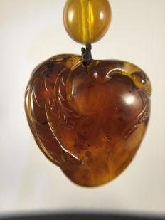 Burma Amber carved  pendant of a peach, weight 28.4 grams