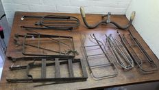 6 old luggage carriers - parcels carriers - and an old steering wheel with wooden handles.