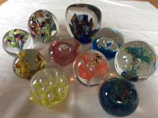 Collection of ten handmade paperweights.