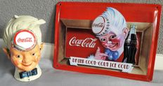 Coca Cola anniversary sign and cast iron piggy bank - from the late 1990s